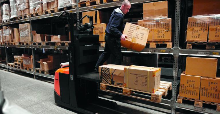 Low level order picker in warehouse