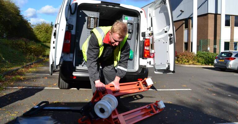Technician next to service van