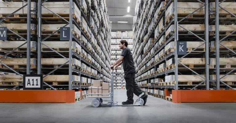 Man handling parts in storage