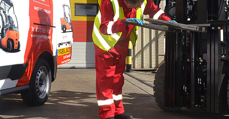 Technician carrying out a thorough examination