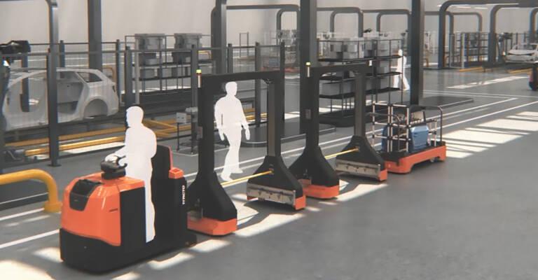 Gráfica de un almacén con tractoras de arrastre de conductor de pie