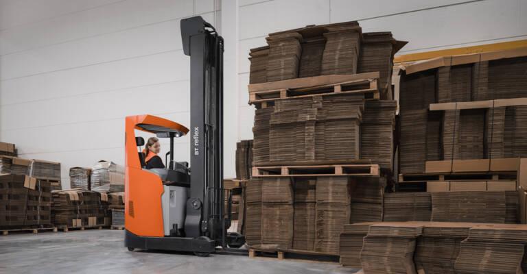 bt reflex reach truck lifting pallets in warehouse