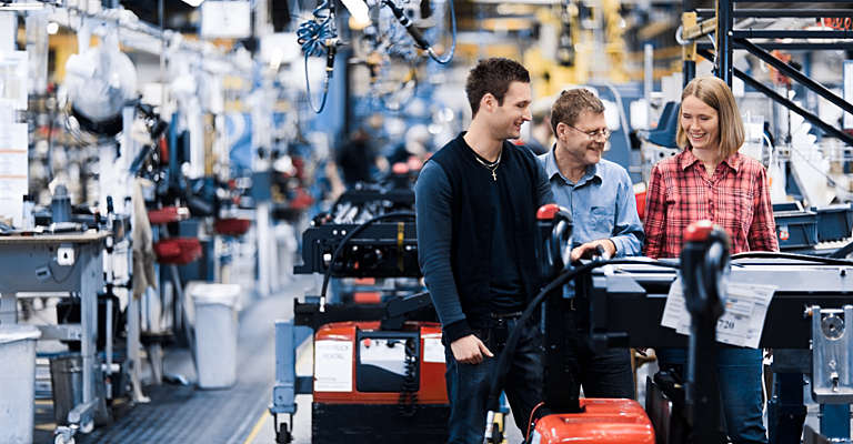 Smiling people in Toyota truck factory