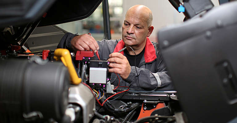 Toyota technician servicing a truck