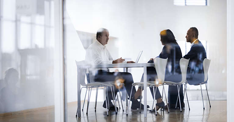 sales people in a meeting